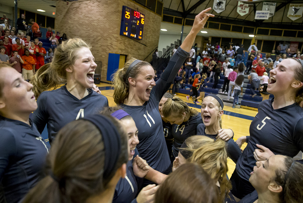 Sacred Heart-Griffin's Delaney Jordan (4) Emma Hopkins (11) and Eilise Cummins (5) celebrate with their teammates after defeating Springfield 27-25, 25-16 to win the Cyclones' first City Volleyball Tournament title since 2008 at Southeast High School, Thursday, Sept. 24, 2015, in Springfield, Ill. Justin L. Fowler/The State Journal-Register
