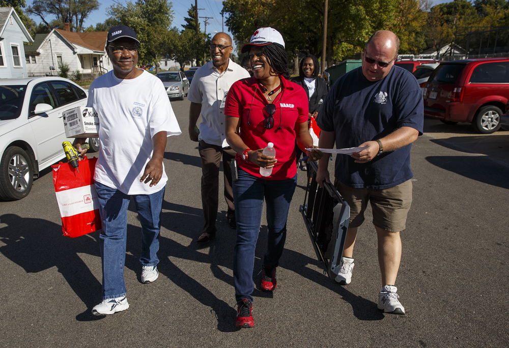 Volunteers, from left, James Bass, Pastor Donald Mayes, Teresa Haley, Nakeya Thompson and Springfield Firefighter Chris Cole carry their tools and smoke detector supplies toward their designated area to begin installing free smoke detectors in area homes Saturday, Sept. 26, 2015. Ted Schurter/The State Journal-Register