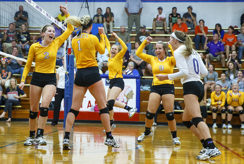The Williamsville Bullets celebrate their match point against Rochester in the second game of the Sangamon County Volleyball Championship at Pawnee High School Monday Sept. 28, 2015. Ted Schurter/The State Journal-Register