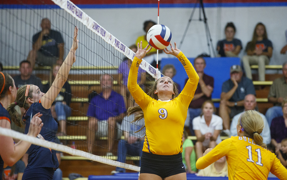 Williamsville's Leah Musselman sets the ball during the Sangamon County Volleyball Championship at Pawnee High School Monday Sept. 28, 2015. Ted Schurter/The State Journal-Register