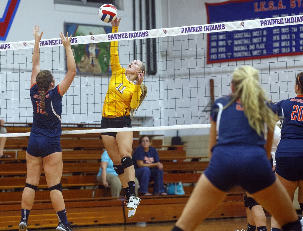 Williamsville's Laney Flynn spikes the ball past Rochester's Shellie Kearney during the Sangamon County Volleyball Championship at Pawnee High School Monday Sept. 28, 2015. Ted Schurter/The State Journal-Register