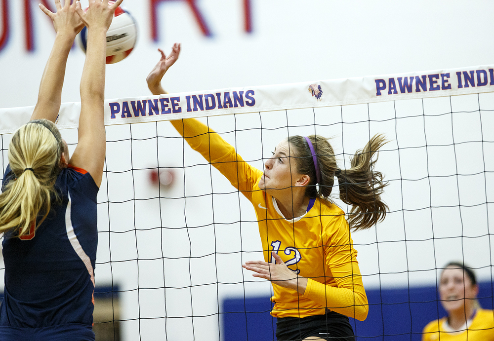 Williamsville's Delaney Edwards spikes the ball in front of Rochester's Cassidy Dooley during the Sangamon County Volleyball Championship at Pawnee High School Monday Sept. 28, 2015. Ted Schurter/The State Journal-Register