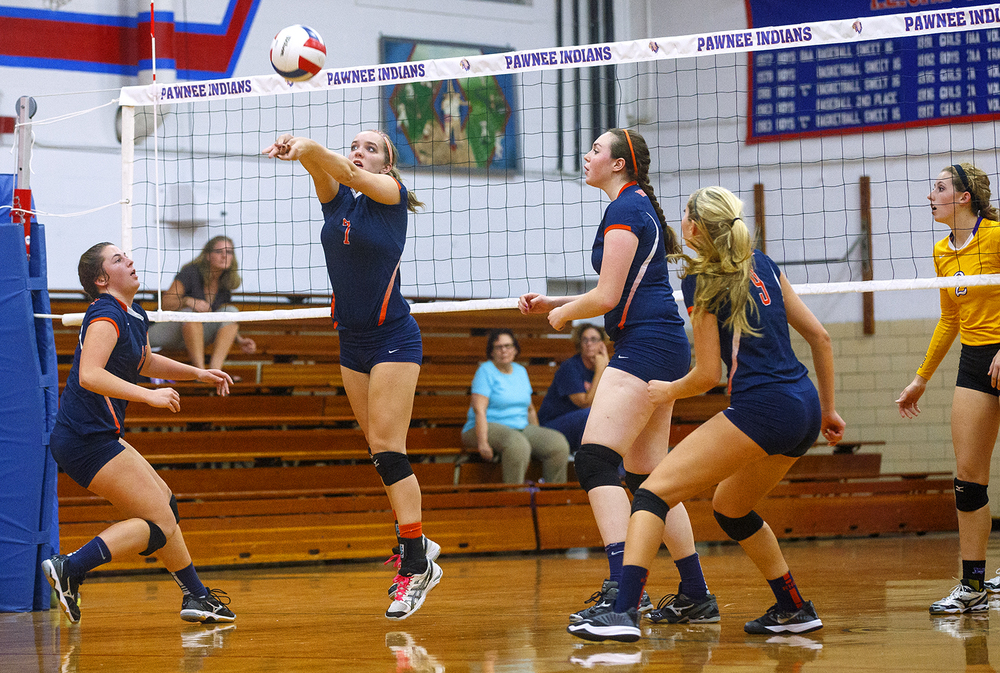 Rochester's Chloe Rickman returns a ball against Williamsville during the Sangamon County Volleyball Championship at Pawnee High School Monday Sept. 28, 2015. Ted Schurter/The State Journal-Register