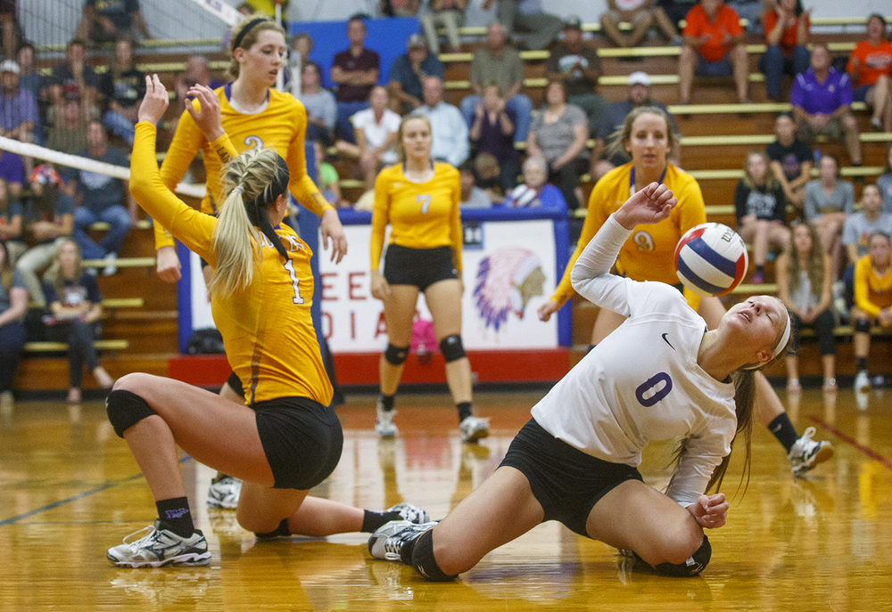 Williamsville's Maggie Sorenson tries to duck a botched pass against Rochester during the Sangamon County Volleyball Championship at Pawnee High School Monday Sept. 28, 2015. Ted Schurter/The State Journal-Register