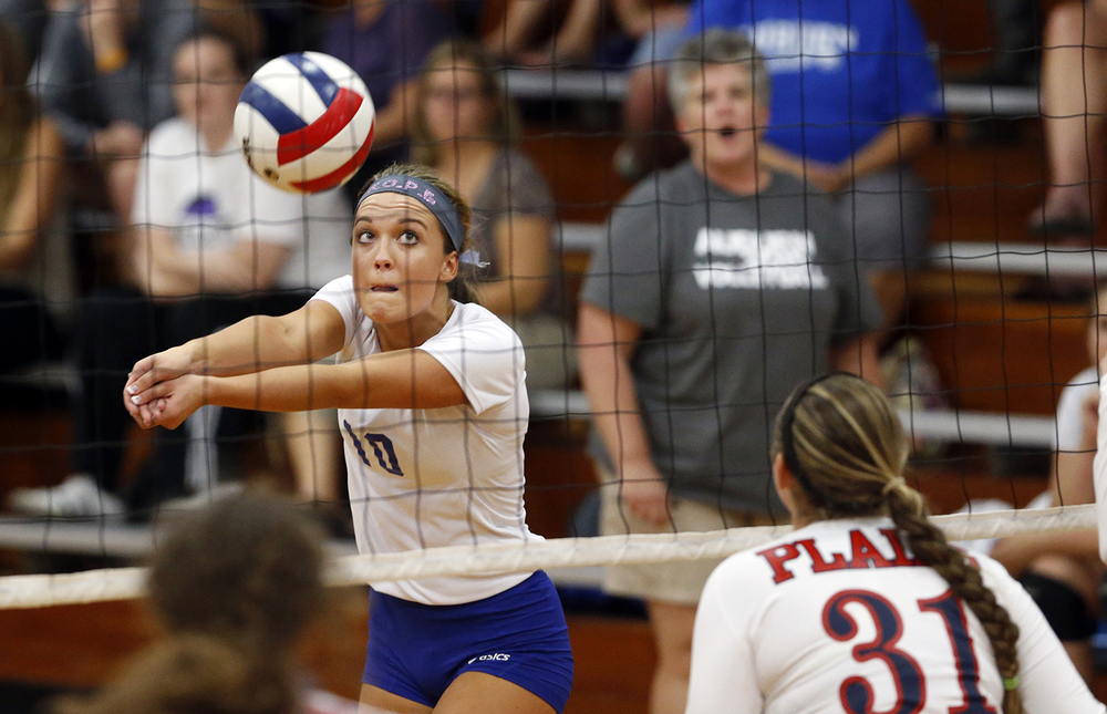 Auburn's Emily Ackerson eyes the ball as she passes it during the Sangamon County Volleyball Tournament at Pawnee High School Monday Sept. 28, 2015. Ted Schurter/The State Journal-Register