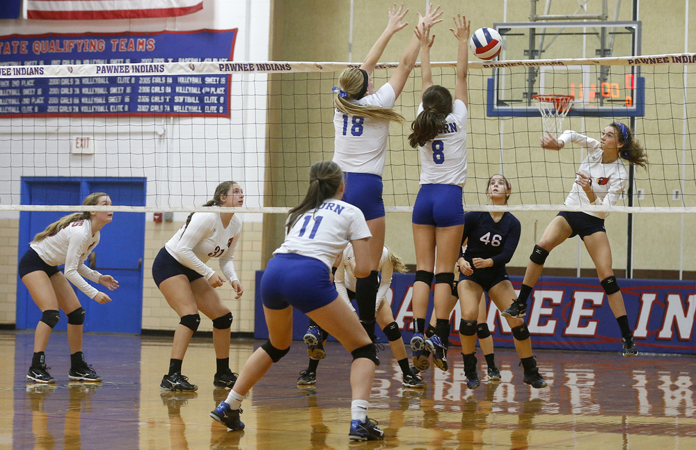 Pleasant Plains' Ali Pankey scores a kill against Auburn during the Sangamon County Volleyball Tournament at Pawnee High School Monday Sept. 28, 2015. Ted Schurter/The State Journal-Register