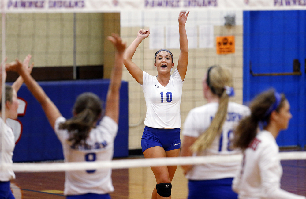 Auburn's Emily Ackerson celebrates a point against Pleasant Plains during the Sangamon County Volleyball Tournament at Pawnee High School Monday Sept. 28, 2015. Ted Schurter/The State Journal-Register