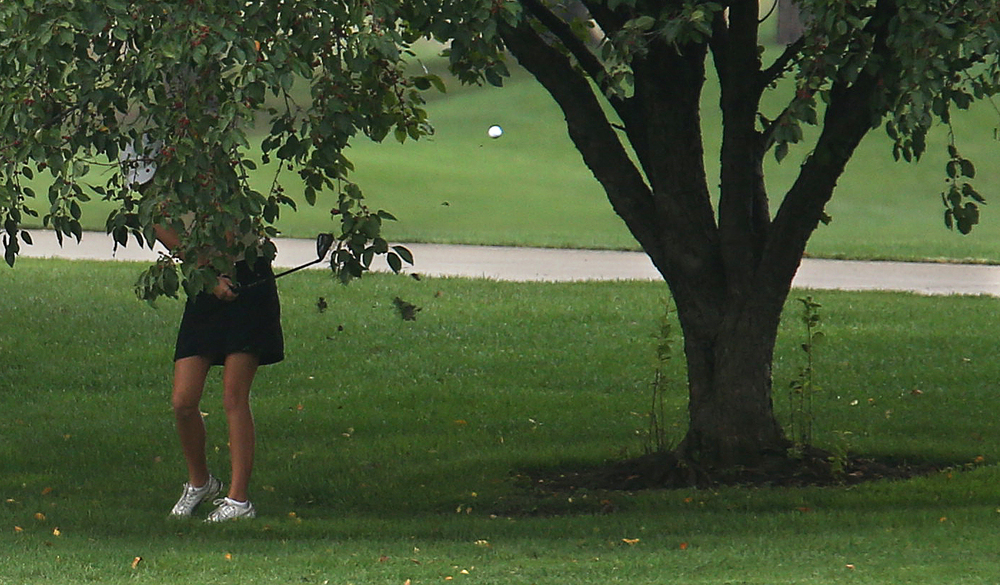 SHG golfer Emily Ducaji drives the ball through an opening of a tree on the tenth green Tuesday. David Spencer/The State Journal-Register