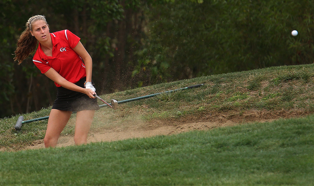 Glenwood's Brooke Metzger drives out of a bunker on the 10th hole Tuesday. David Spencer/The State Journal-Register