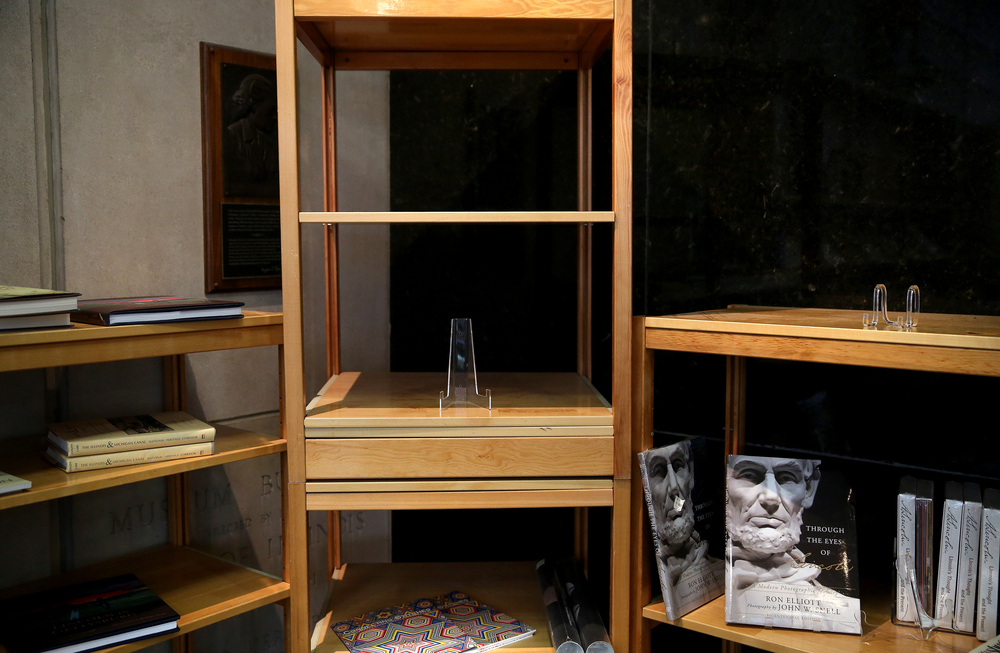 Book display shelves were nearly empty inside the museum gift shop on Wednesday morning. David Spencer/The State Journal-Register
