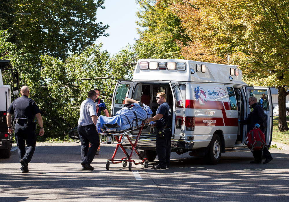 A person injured by a collapsed tree in the 800 block of West Jefferson Street is placed into a ambulance with minor injuries, Wednesday, Sept. 30, 2015, in Springfield, Ill. Justin L. Fowler/The State Journal-Register