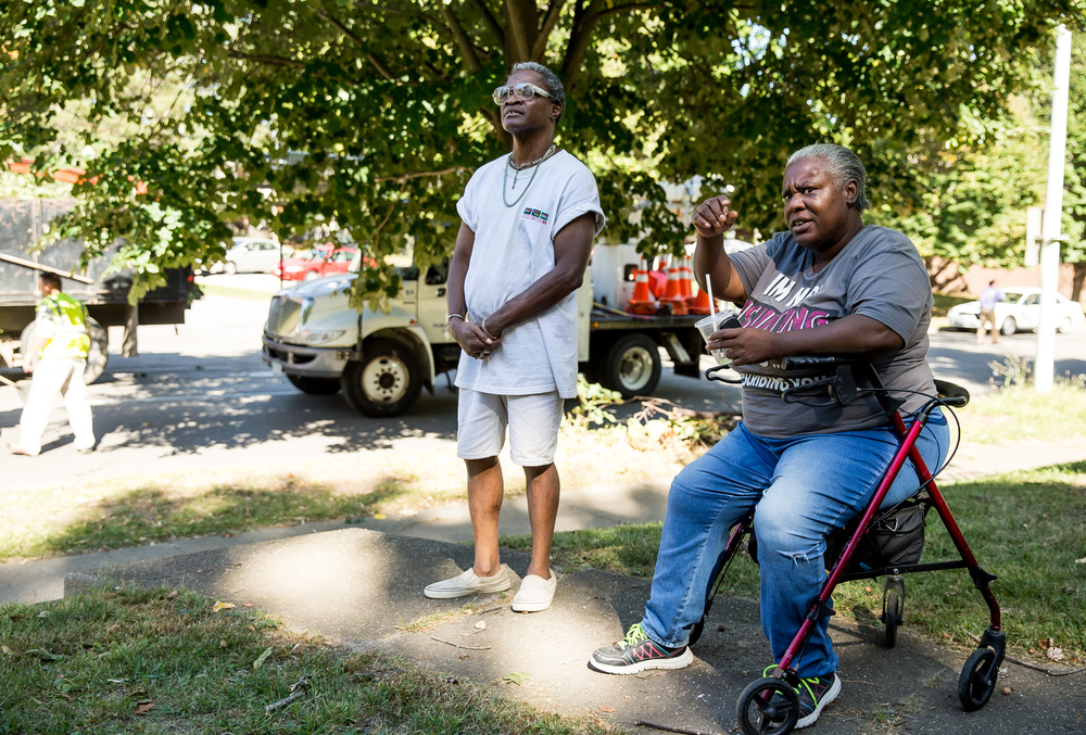 """I'm lucky to be alive,"" said Freddie Acres, left, as he talks with Denise Holmes, right, about a tree that collapsed in front of a home on the 800 block of West Jefferson Street, Wednesday, Sept. 30, 2015, in Springfield, Ill. Acres was walking on the sidewalk back to his apartment right as the tree collapsed. Justin L. Fowler/The State Journal-Register"
