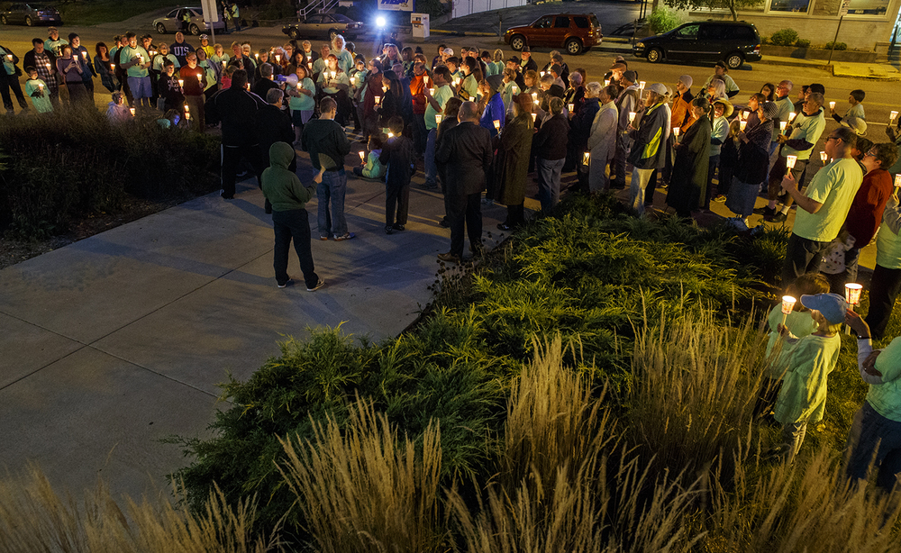 About 100 people gathered for a candlelight protest in front of the Illinois State Museum in Springfield, Ill., Thursday Oct. 1, 2015. Gov. Bruce Rauner's administration initially planned to close the museum Wednesday and lay off all but three of its staff members. The museum closed to the public Thursday but the American Federation of State, County and Municipal Employees, which represents most of the museum employees still on the job, is challenging the layoffs in court, saying they did not comply with the union's labor contract. Ted Schurter/The State Journal-Register