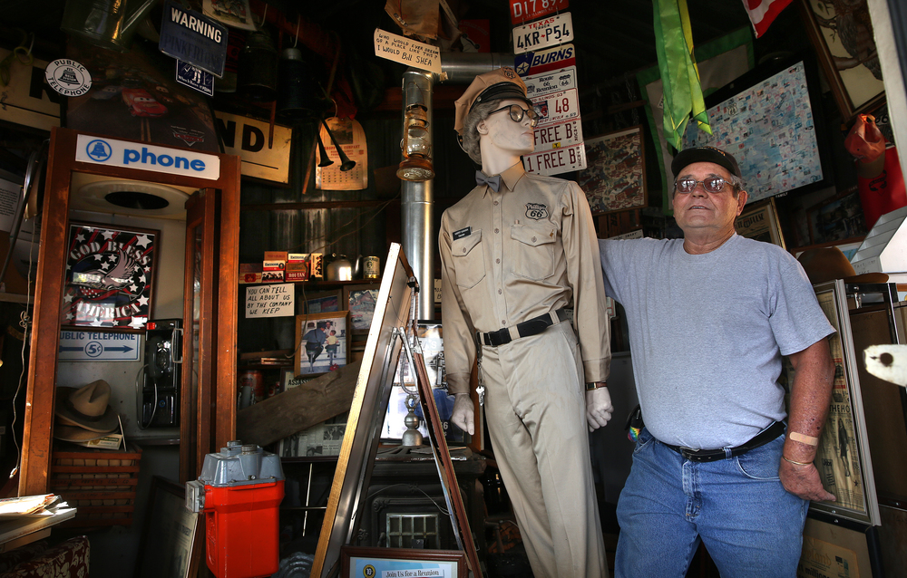 Bill Shea Jr. stands with a mannequin depicting Harry Mahan, proprietor of Mahan's, believed to be one of the oldest filling stations in Illinois going back to the 1920's that was moved to the Shea's museum property from Middletown, IL. and fully restored in 2000. Photograph taken on Thursday, Oct. 1, 2015. David Spencer/The State Journal-Register