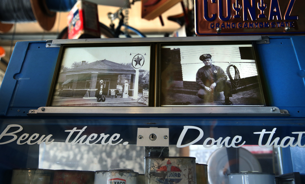 Vintage photographs showing Bill Shea from the late 1940's and the Texaco station he owned and ran at 2001 Peoria Rd. are seen inside the museum on Thursday, Oct. 1, 2015. Personal family photos like these will be kept by the family. David Spencer/The State Journal-Register
