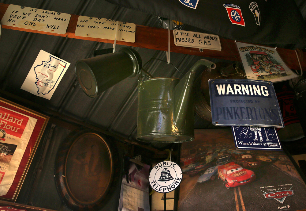 Vintage oil cans and signs hang from the ceiling inside the former Mahan's filling station on the museum property seen Thursday, Oct. 1, 2015. David Spencer/The State Journal-Register