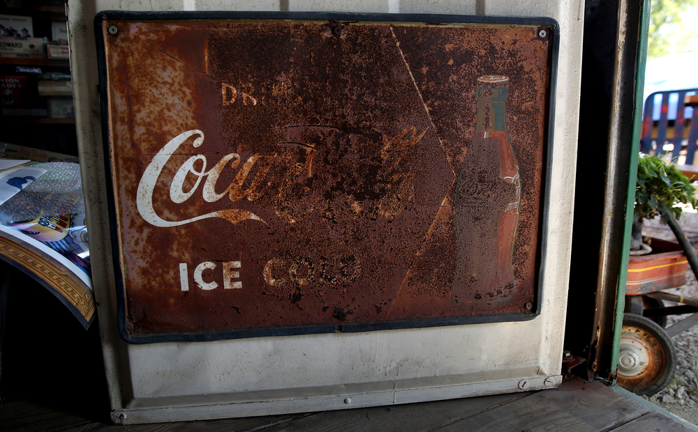 A vintage and heavily rusted Coca-Cola tin sign is seen on the front door of the former Mahan's filling station on the museum property seen Thursday, Oct. 1, 2015. David Spencer/The State Journal-Register