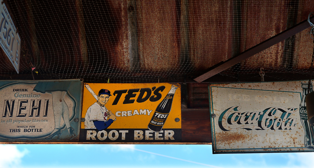 A vintage Ted Williams rootbeer sign is attached along with other signs above the carport area of the former Mahan's filling station on the museum property seen here on Thursday, Oct. 1, 2015. David Spencer/The State Journal-Register