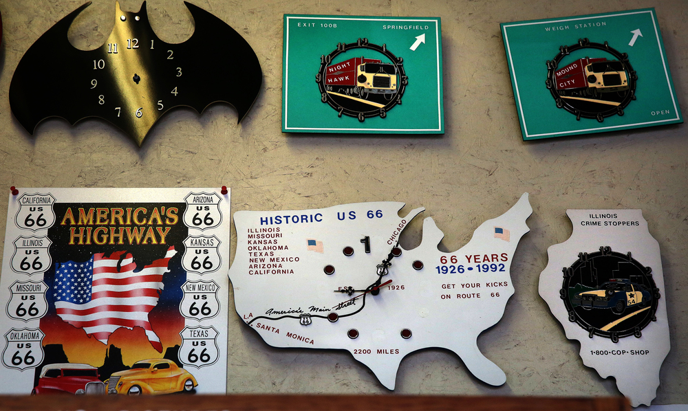 Hand-made fiberglass clocks, some with a Route 66 theme, hang inside the main museum seen here Thursday, Oct. 1, 2015. David Spencer/The State Journal-Register