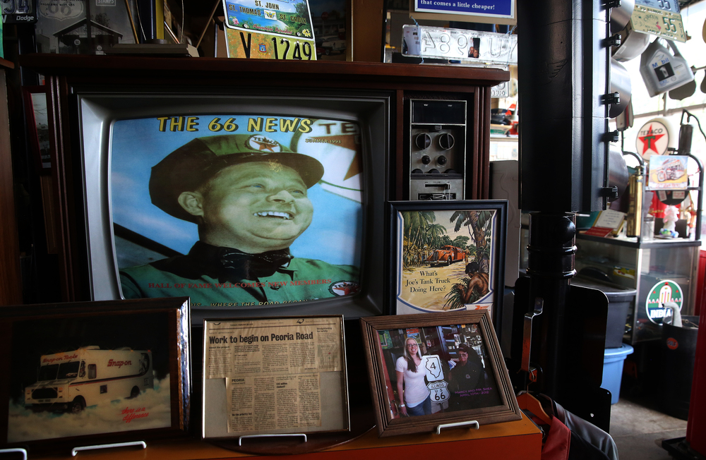 An old television displays a photograph of Bill Shea from 1950 wearing his Texaco uniform, seen here on Thursday, Oct. 1, 2015. David Spencer/The State Journal-Register