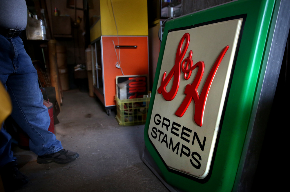 A vintage S&H Green Stamps sign removed from the store it was located in from downtown Springfield will be auctioned on Nov. 21, seen here inside the main museum on Thursday, Oct. 1, 2015.  David Spencer/The State Journal-Register