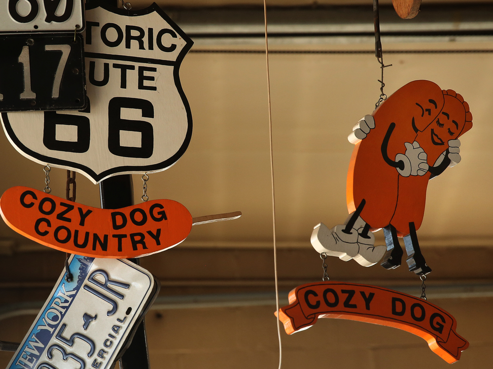 A sign for another Route 66 landmark: the Cozy Dog, hangs from the ceiling along with other items inside the main museum seen here on Thursday, Oct. 1, 2015. David Spencer/The State Journal-Register