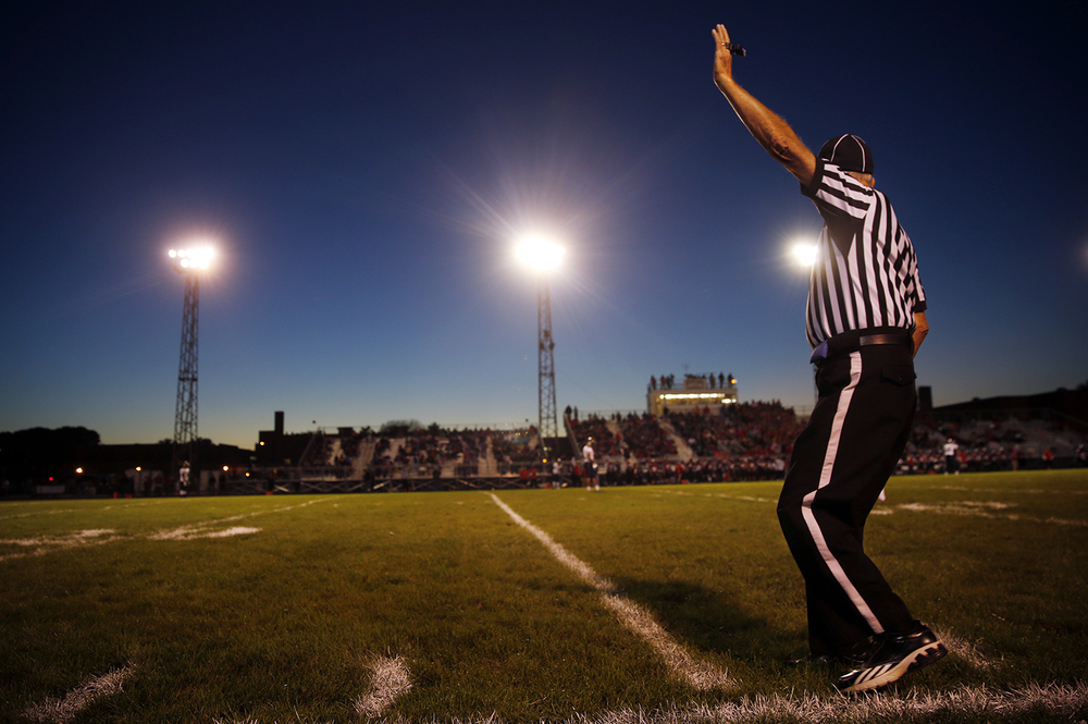 A game official signals for the start of the Springfield and Southeast football game at Memorial Stadium Friday, Oct. 2, 2015. Ted Schurter/The State Journal-Register