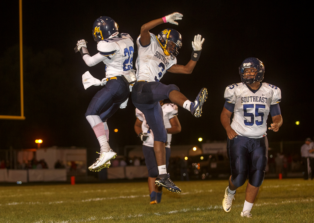 Southeast's Decorian Sexton (22) and Tae Smith (3) celebrate after Smith converted a two-point conversion against Springfield at Memorial Stadium Friday, Oct. 2, 2015. Ted Schurter/The State Journal-Register