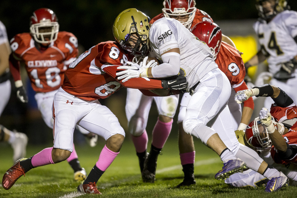 Sacred Heart-Griffin's Sam Sergent (28) lowers his shoulder into Glenwood's Devin Foy (89) for a touchdown in the first quarter to make it 10-0 SHG at Glenwood High School, Friday, Oct. 2, 2015, in Chatham, Ill. Justin L. Fowler/The State Journal-Register