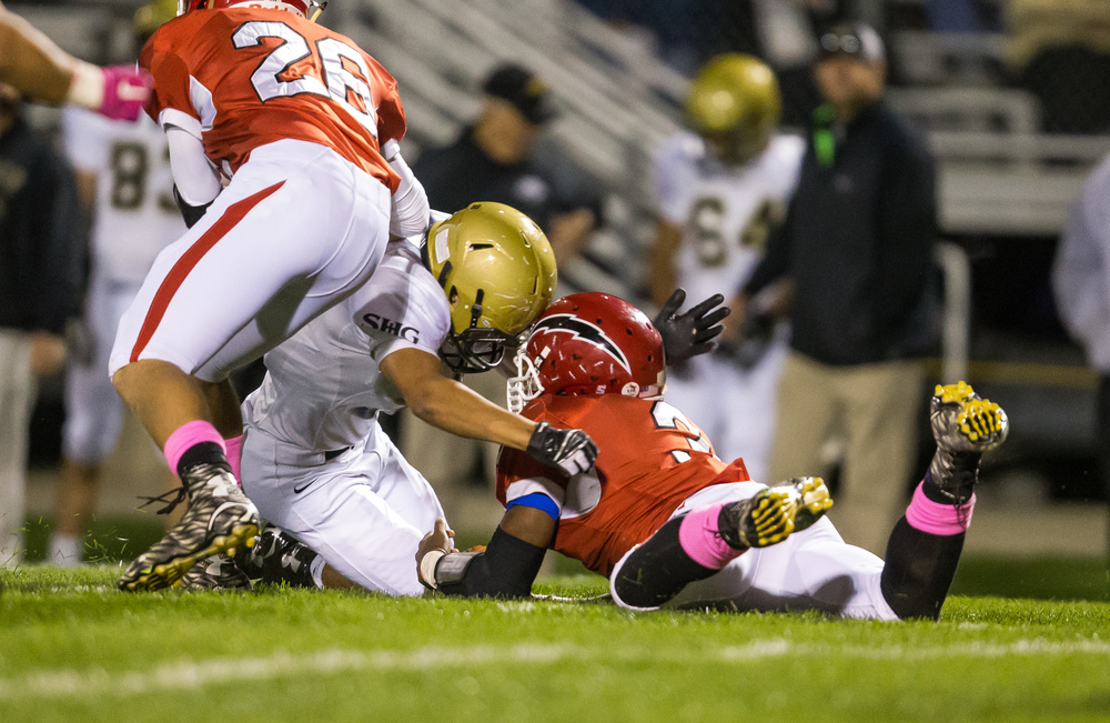Glenwood's Jabores Smith (3) is injured on a collision with Sacred Heart-Griffin's Tristan Blair (32) while diving to recover a fumble in the fist half at Glenwood High School, Friday, Oct. 2, 2015, in Chatham, Ill. Justin L. Fowler/The State Journal-Register