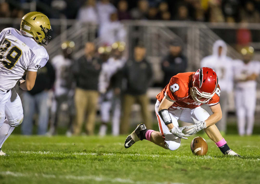 Glenwood's Brandon Hay (8) tries to pick up a fumble in the backfield against the Cyclones in the fist half at Glenwood High School, Friday, Oct. 2, 2015, in Chatham, Ill. Justin L. Fowler/The State Journal-Register