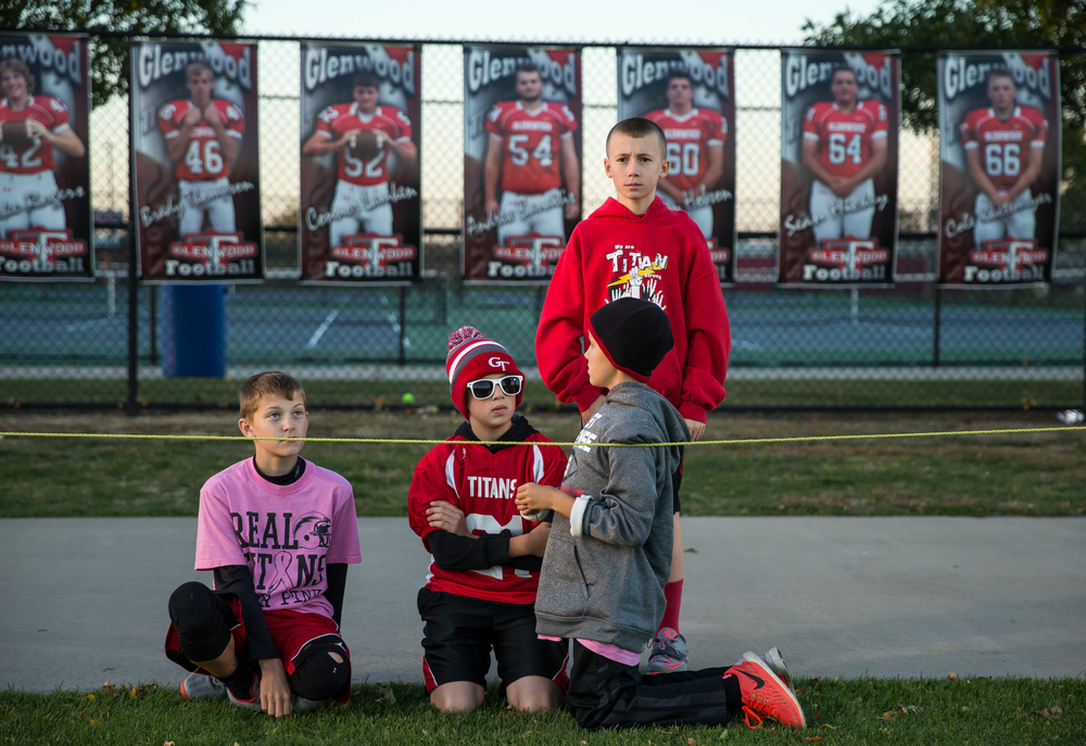 Young Glenwood fans watch along the sidelines as the Titans prepare to take on Sacred Heart-Griffin at Glenwood High School, Friday, Oct. 2, 2015, in Chatham, Ill. Justin L. Fowler/The State Journal-Register