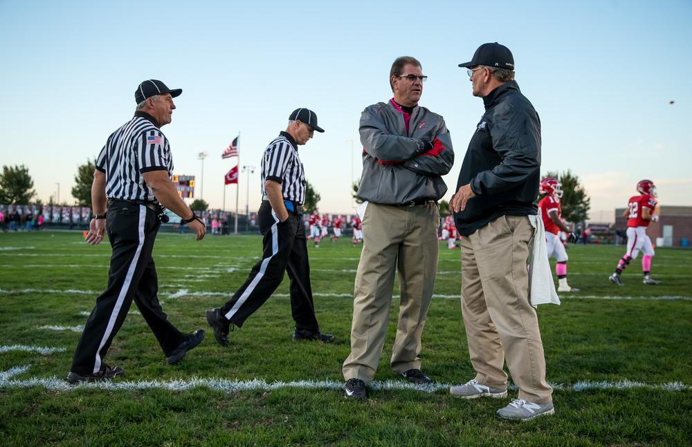 Glenwood head football coach Dan Rourke and Sacred Heart-Griffin head football coach Ken Leonard have a conversation at midfield as their teams get warmed up prior to kickoff at Glenwood High School, Friday, Oct. 2, 2015, in Chatham, Ill. Justin L. Fowler/The State Journal-Register
