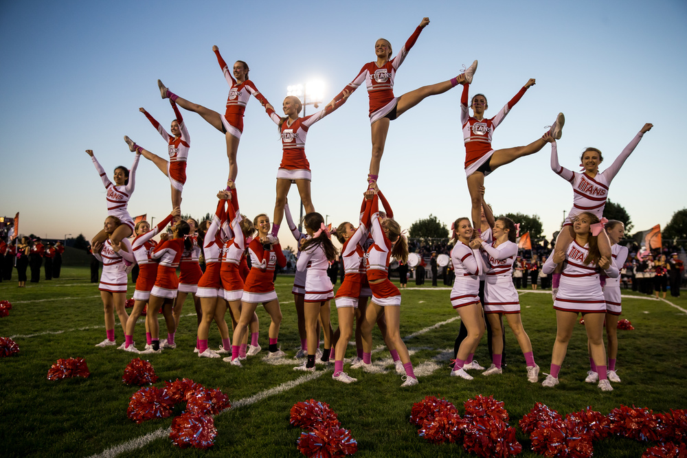 The Glenwood cheerleaders perform with the marching band prior to kickoff against Sacred Heart-Griffin at Glenwood High School, Friday, Oct. 2, 2015, in Chatham, Ill. Justin L. Fowler/The State Journal-Register