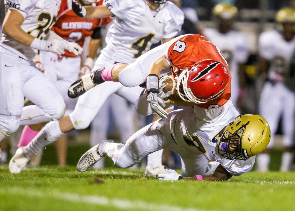 Sacred Heart-Griffin's Avery Andrews (7) brings down Glenwood's Brandon Hay (8) on a rush in the fist half at Glenwood High School, Friday, Oct. 2, 2015, in Chatham, Ill. Justin L. Fowler/The State Journal-Register