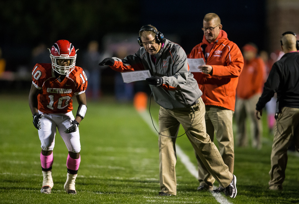 Glenwood head football coach Dan Rourke calls in a play to Glenwood's David Jones (10) as the Titans take on Sacred Heart-Griffin in the fist half at Glenwood High School, Friday, Oct. 2, 2015, in Chatham, Ill. Justin L. Fowler/The State Journal-Register