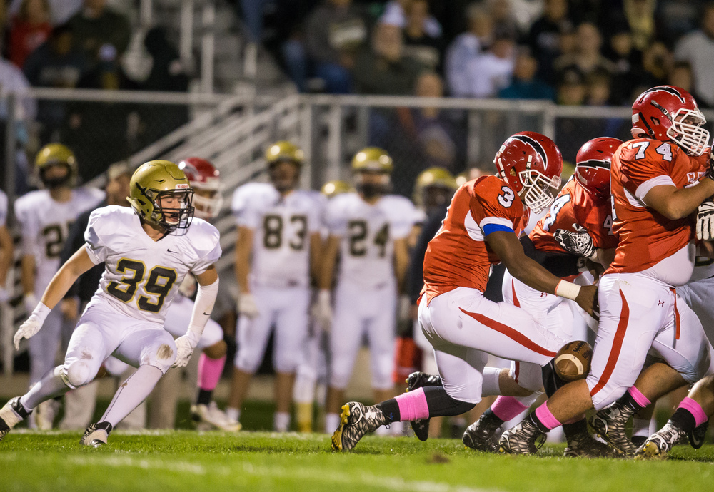 Glenwood's Jabores Smith (3) fumbles the ball on a rush against Sacred Heart-Griffin in the fist half at Glenwood High School, Friday, Oct. 2, 2015, in Chatham, Ill. SHG's Luke Notz (39) recovered the fumble for the Cyclones. Justin L. Fowler/The State Journal-Register