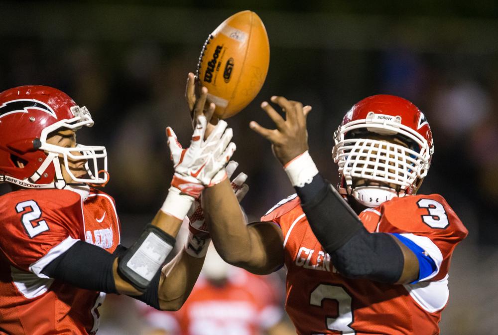 Glenwood's Kameron Corner (2) and Jabores Smith (3) bobble a squib kickoff from Sacred Heart-Griffin in the fist half at Glenwood High School, Friday, Oct. 2, 2015, in Chatham, Ill. Justin L. Fowler/The State Journal-Register