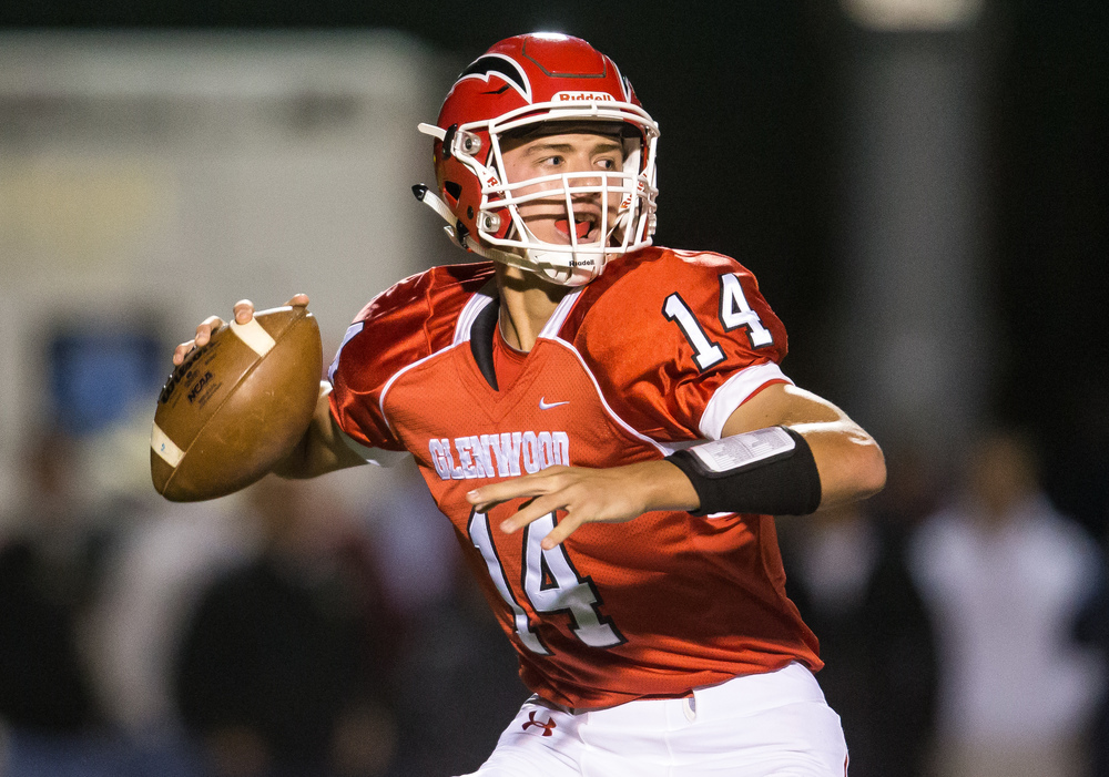 Glenwood's Cole Hembrough (14) drops back for a pass against Sacred Heart-Griffin in the fist half at Glenwood High School, Friday, Oct. 2, 2015, in Chatham, Ill. Justin L. Fowler/The State Journal-Register