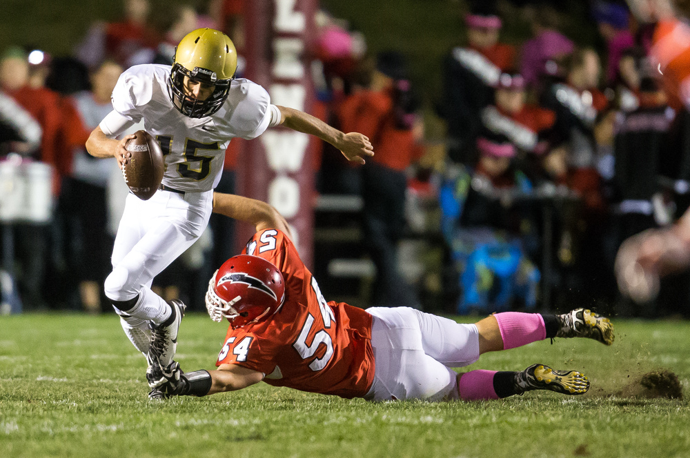 Glenwood's Andrew Banaitis (54) chases Sacred Heart-Griffin's Tim Brenneisen (15) out of the pocket forcing him to run in the fist half at Glenwood High School, Friday, Oct. 2, 2015, in Chatham, Ill. Brenneisen would fumble the ball on the play and the Titans would recover. Justin L. Fowler/The State Journal-Register