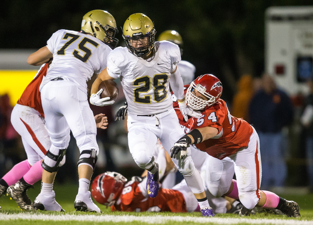Sacred Heart-Griffin's Sam Sergent (28) breaks a tackle from Glenwood's Andrew Banaitis (54) on a rush in the second half at Glenwood High School, Friday, Oct. 2, 2015, in Chatham, Ill. Justin L. Fowler/The State Journal-Register