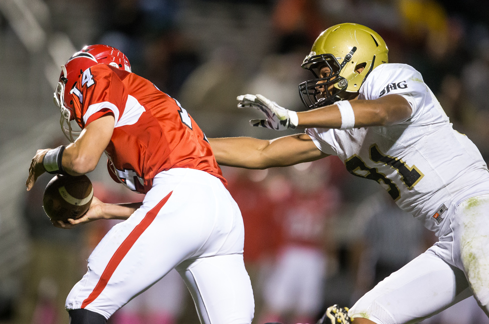 Sacred Heart-Griffin's Albert Okwuegbunam (81) sacks Glenwood's Cole Hembrough (14) in the backfield for a loss in the second half at Glenwood High School, Friday, Oct. 2, 2015, in Chatham, Ill. Justin L. Fowler/The State Journal-Register