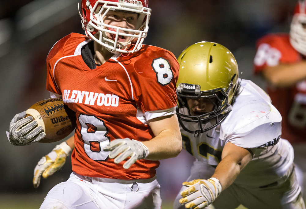 Glenwood's Brandon Hay (8) tries to evade a tackle from a Sacred Heart-Griffin defender on a rush in the second half at Glenwood High School, Friday, Oct. 2, 2015, in Chatham, Ill. Justin L. Fowler/The State Journal-Register