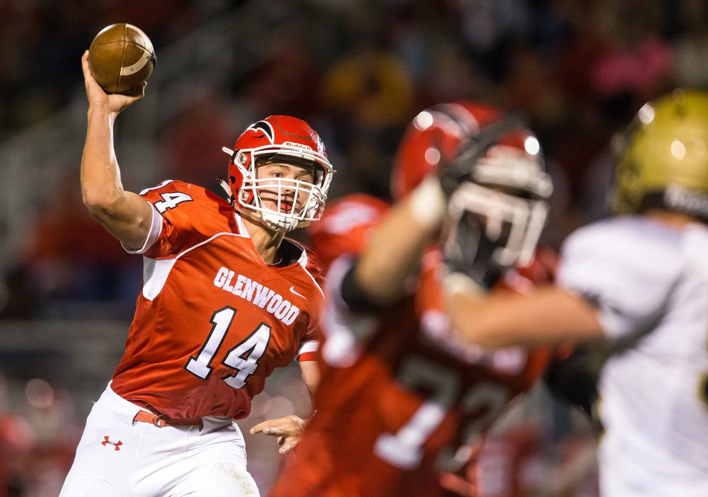 Glenwood's Cole Hembrough (14) launches a pass against Sacred Heart-Griffin in the second half at Glenwood High School, Friday, Oct. 2, 2015, in Chatham, Ill. Justin L. Fowler/The State Journal-Register