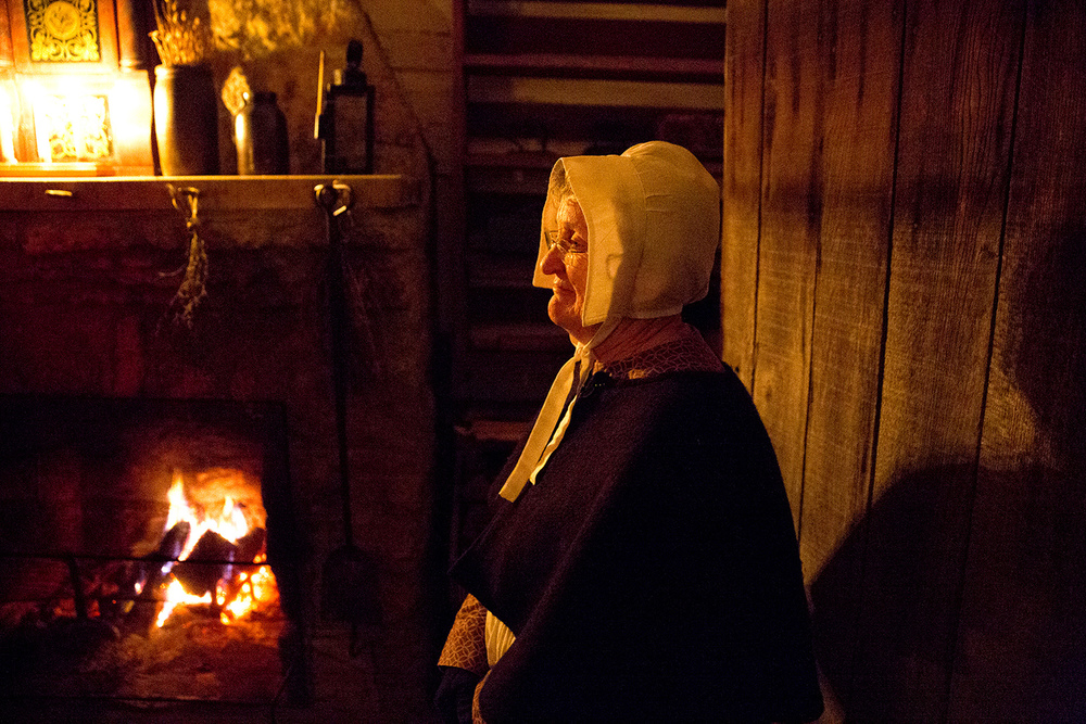 Mary Mulcahy, a volunteer at New Salem State Historic Site, greeted visitors in Dr. John Allen's home and office during the park's annual Candlelight Walk Friday, Oct. 2, 2015. Rich Saal/The State Journal-Register