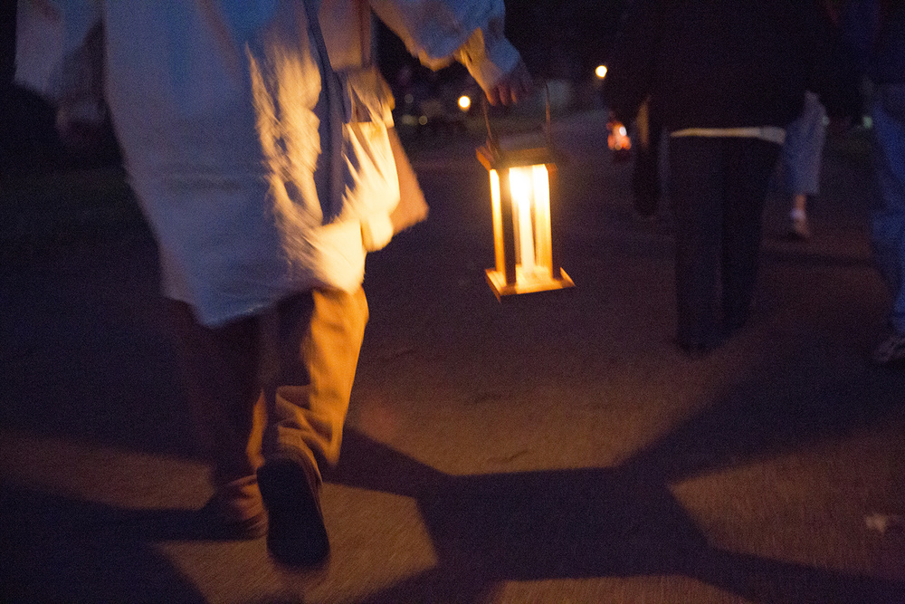 Terry Jones, interpreter coordinator at New Salem State Historic Site, walks through the village during the annual Candlelight Walk Friday, Oct. 2, 2015. Rich Saal/The State Journal-Register