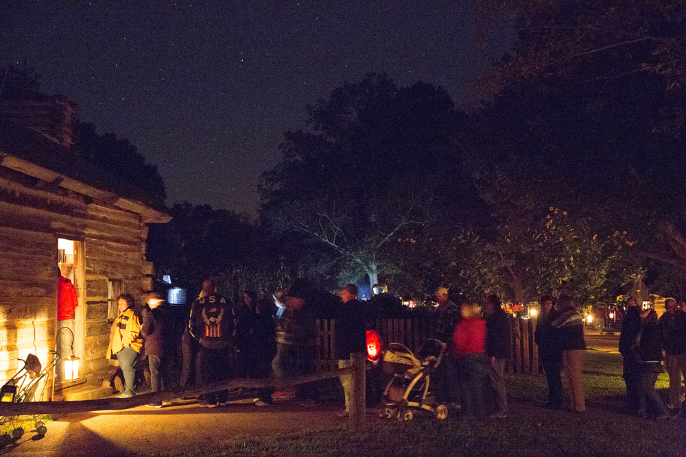 Visitors line up outside one of the homes in the New Salem State Historic Site during the candlelight tour Friday, Oct. 2, 2015. Rich Saal/The State Journal-Register