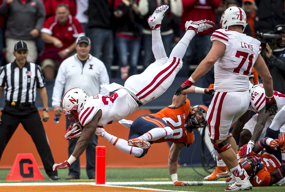 Nebraska Cornhuskers running back Devine Ozigbo (22) leaps into the end zone over Illinois Fighting Illini defensive back Clayton Fejedelem (20) on a 19-yard touchdown run in the second quarter at Memorial Stadium, Saturday, Oct. 3, 2015, in Champaign, Ill. Justin L. Fowler/The State Journal-Register