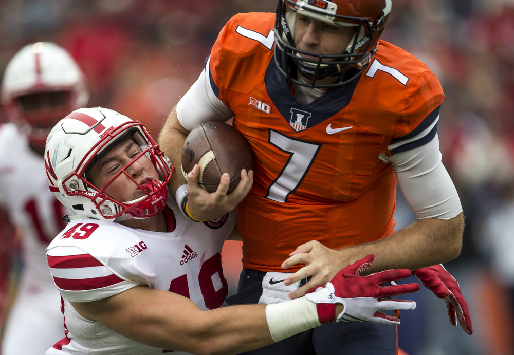 Nebraska Cornhuskers linebacker Chris Weber (49) stops Illinois Fighting Illini quarterback Chayce Crouch (7) for a  loss of 3 yards on fourth down to force a turnover on downs in the first quarter at Memorial Stadium, Saturday, Oct. 3, 2015, in Champaign, Ill. Justin L. Fowler/The State Journal-Register