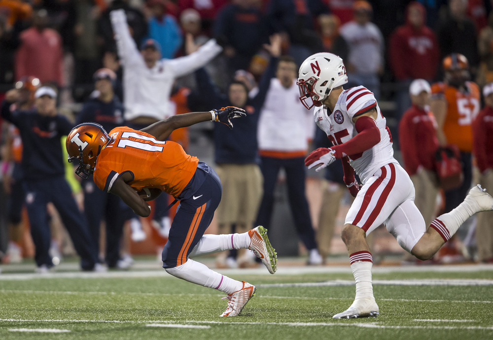 Illinois Fighting Illini wide receiver Malik Turner (11) makes a 50-yard catch against Nebraska Cornhuskers safety Nate Gerry (25) to put the Illini in scoring position late in the fourth quarter at Memorial Stadium, Saturday, Oct. 3, 2015, in Champaign, Ill. Justin L. Fowler/The State Journal-Register